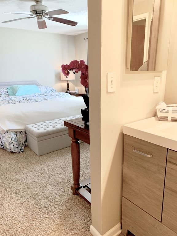 Master suite with King size plush double pillow top bed.