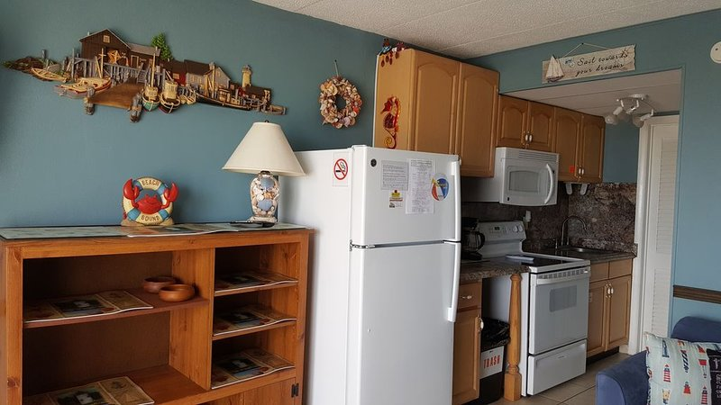 4 burner stove with oven full size sink, full size refrigerator with freezer