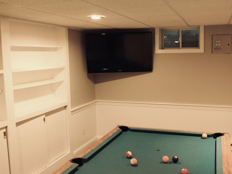 Game room has full size billiard table, books, puzzles games and cable TV.