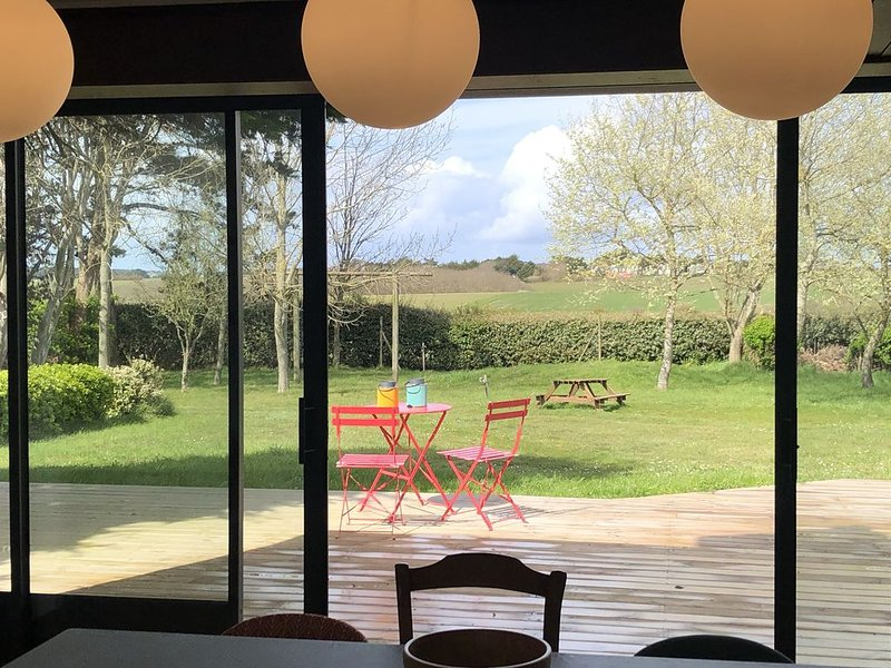 View of the dining room towards the terrace and the garden.