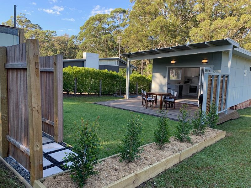 level landscaped courtyard and deck