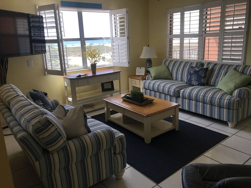 Watch the exquisite sunsets over the Gulf of Mexico from your living room!!