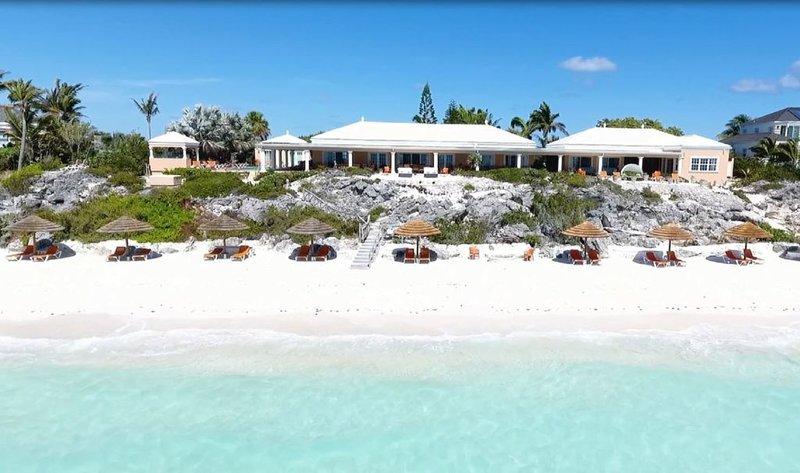 Luxurious 4-12 Bedroom Sandy Beachfront Tennis Villa ~ 24/7 Dedicated Concierge, holiday rental in Long Bay Beach