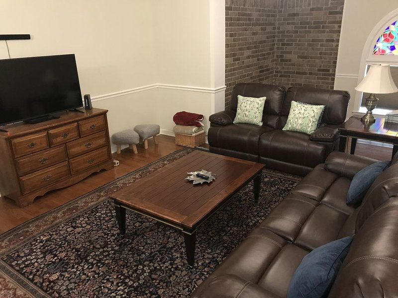 Media room, streaming, dvds, power recliners.
