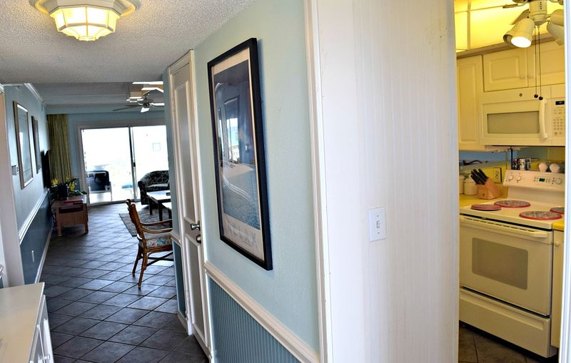 Just inside the front door - kitchen is to the right, and beach is straight ahead! Beautiful view from the living room.