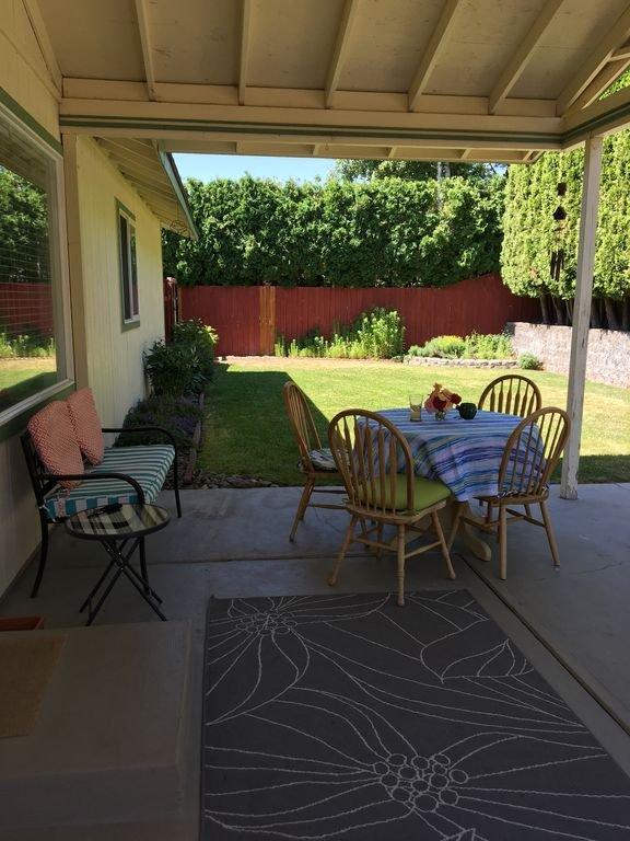 Private backyard with grassy area.
