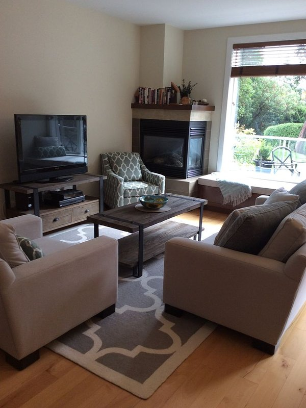 Living room w/ furniture from Urban Barn and window seat cushion for relaxation