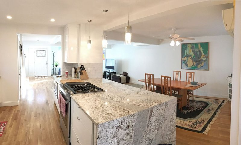 Designer granite kitchen with stainless steel appliances and gas stove