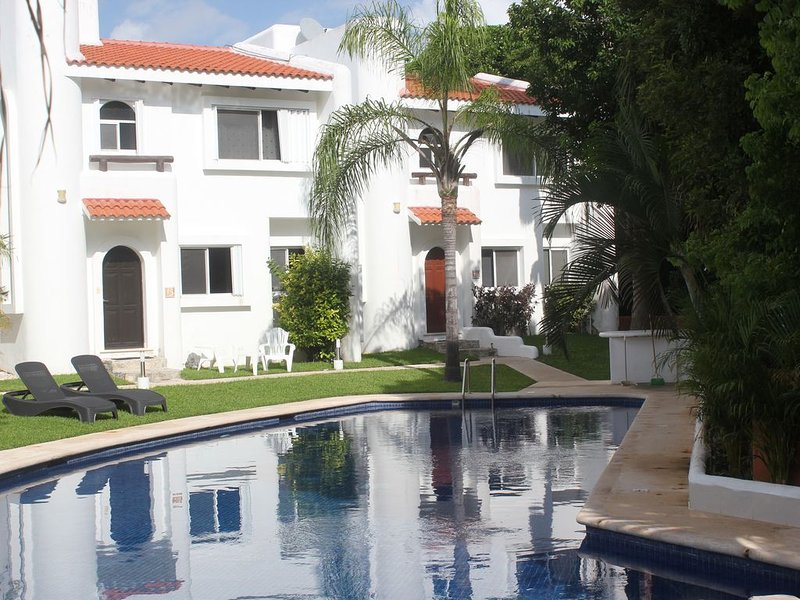 Relax at the front of the house by the pool, use the shaded palapa or the garden
