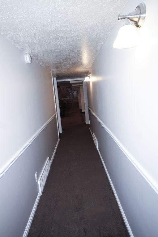Hallway from living room area to bedrooms and bathroom/sauna
