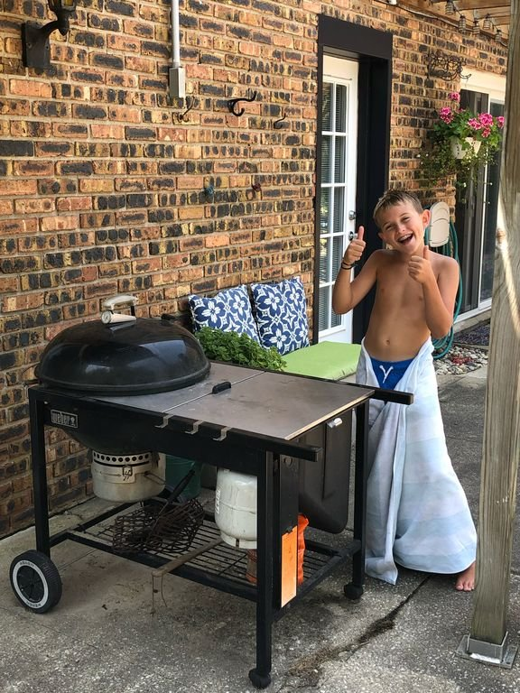 Propane start/charcoal grill-outdoors back yard