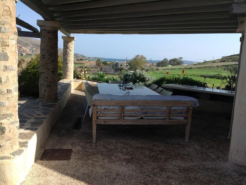 Complex of small Stone Houses in a Vineyard, close to the sea, holiday rental in Kolimpithres