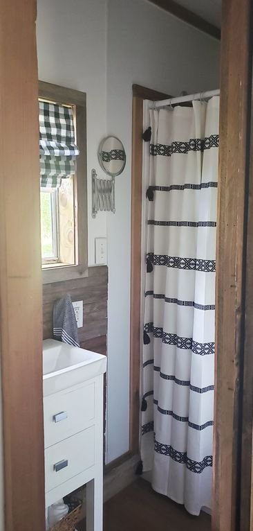 Bathroom with shower, sink & toilet
