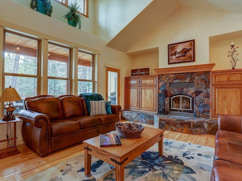 Great room with comfy leather furniture and muscular fireplace.  Opens to elevated deck overlooking the waterway.