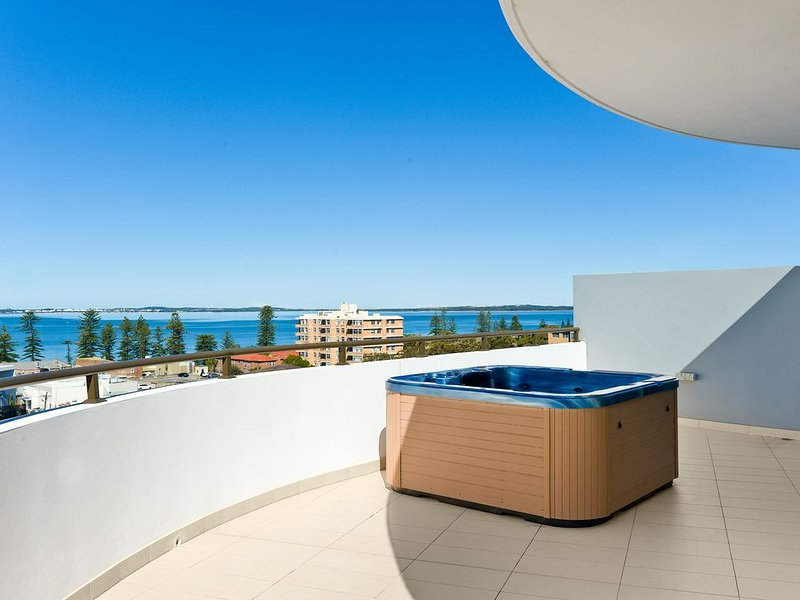 Enjoy the ocean views with a drink of your choice in your own private spa.