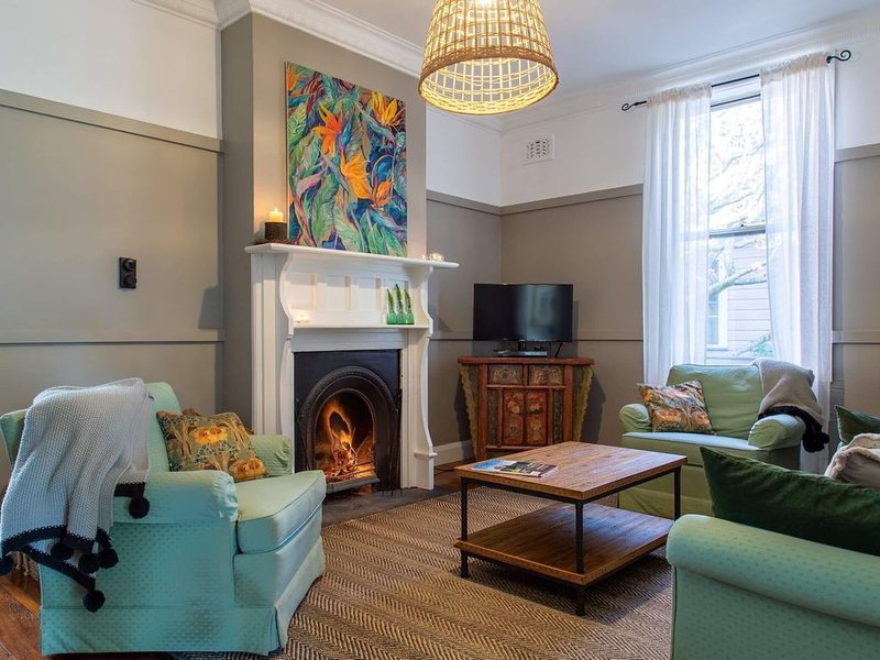 Sitting room with open fire for cosy winter nights.  Reverse cycle air con also