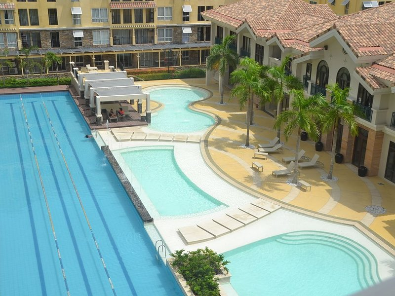 2 br 1tb at Amalfi Oaisis *City De Mare w/ 20 mbps Wifi, holiday rental in Talisay City