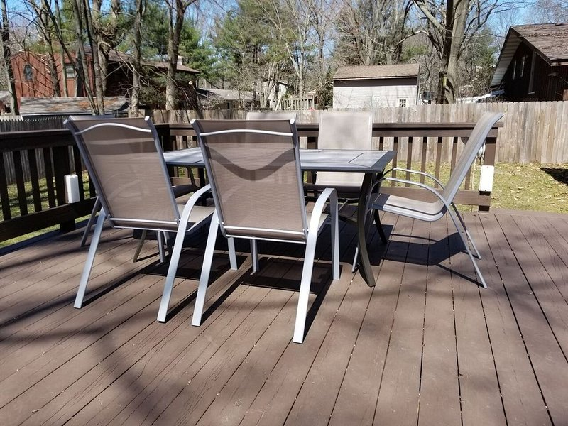 Large deck with grill and dining for six people