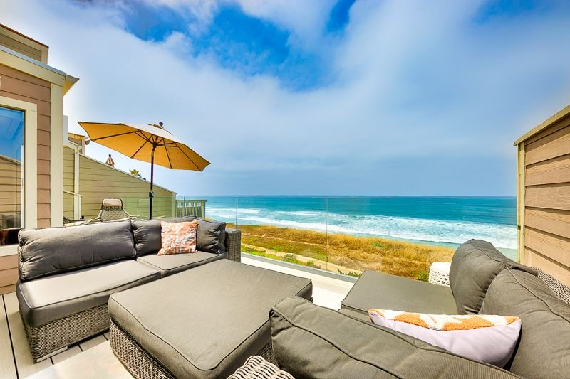 Beautiful outside balcony with sweeping ocean views and lots of comfortable furniture to enjoy them from.