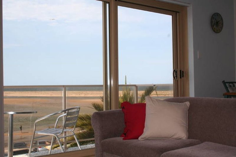 From your living room, straight across the channel and out to sea.