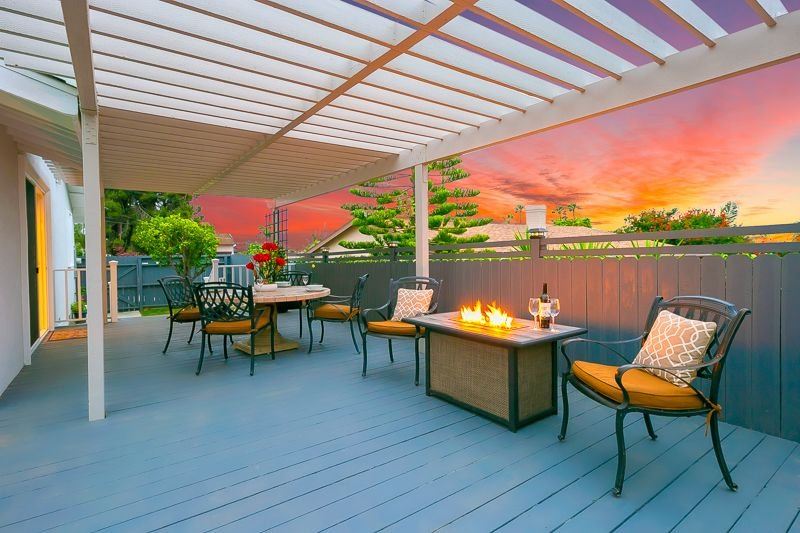 Welcome to this sunset background spacious outdoor deck - perfect for dining al fresco and enjoying an evening around the fire pit.