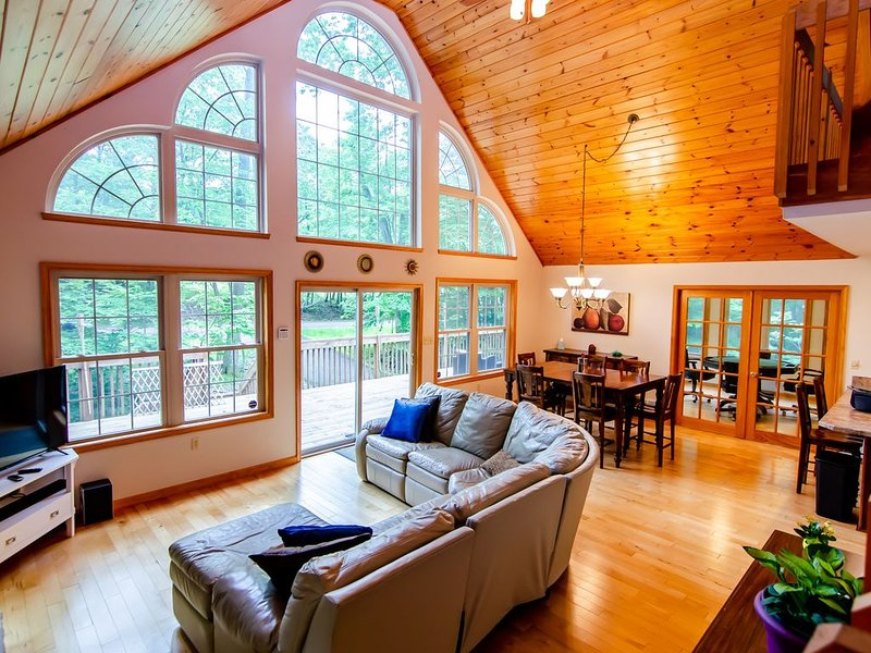 Main Living Space. Tons of natural light and seating for everyone! 2 Roku-HDTVs