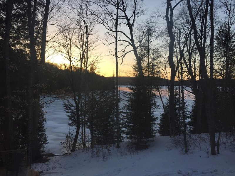 Winter sunrise view to lake from cottage