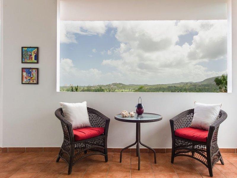 The terrace enjoys golf and mountain views.