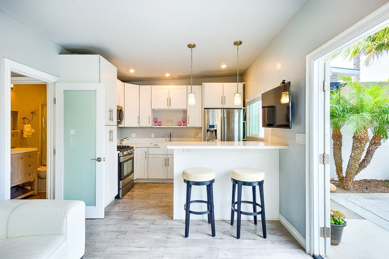 Bar height seating gives a birds eye view of what the cook is creating in this updated kitchen.
