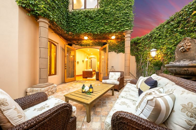 Beautiful patio with comfortable Tuscan oriented seating  is a great place to have morning coffee or rest a bit while sipping an evening libation.