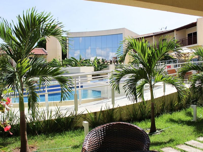 Lindo Flat com varanda de frente para a piscina e boa localização por Carpediem, casa vacanza a Praia de Pipa