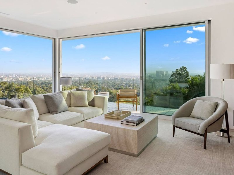 Designer furniture throughout the home. Amazing views of Beverly Hills.