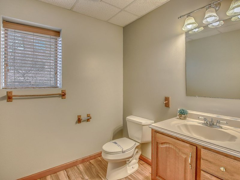 An Image of the Bathroom and Window.