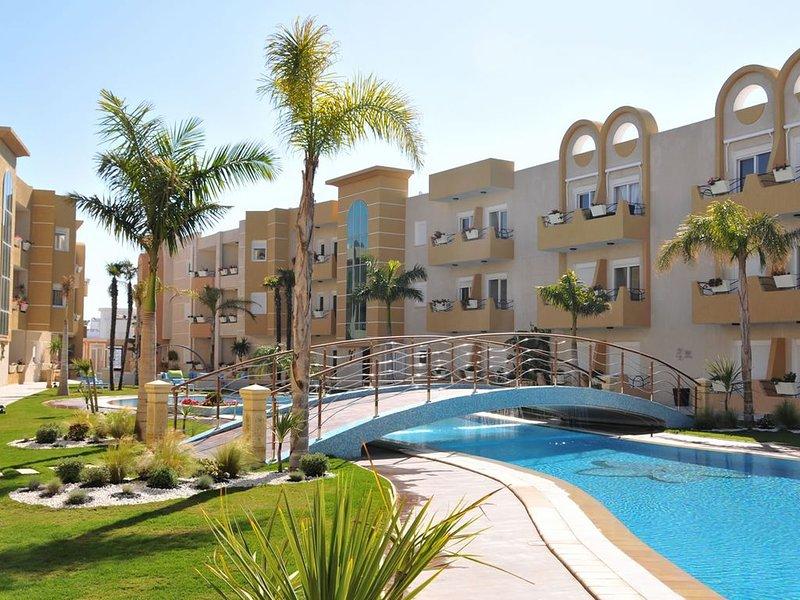 Modern 2 bedroom apartment on the 5 star Dunes Resort, Port El Kantaoui, vacation rental in Sousse