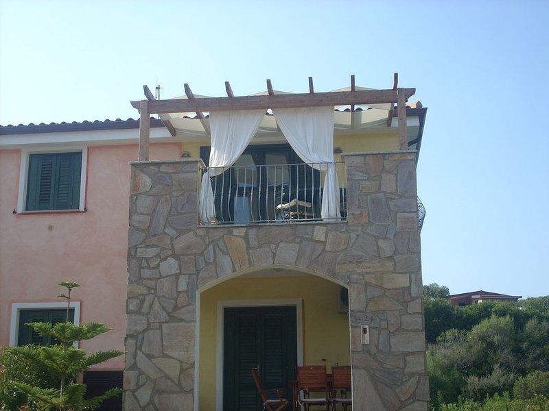 Appartamento in residence con piscina, location de vacances à Santa Maria Coghinas