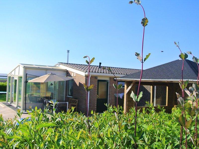 Ruime bungalow met grote tuin en wijds uitzicht over prachtige Zeeuwse polder, alquiler vacacional en Kamperland