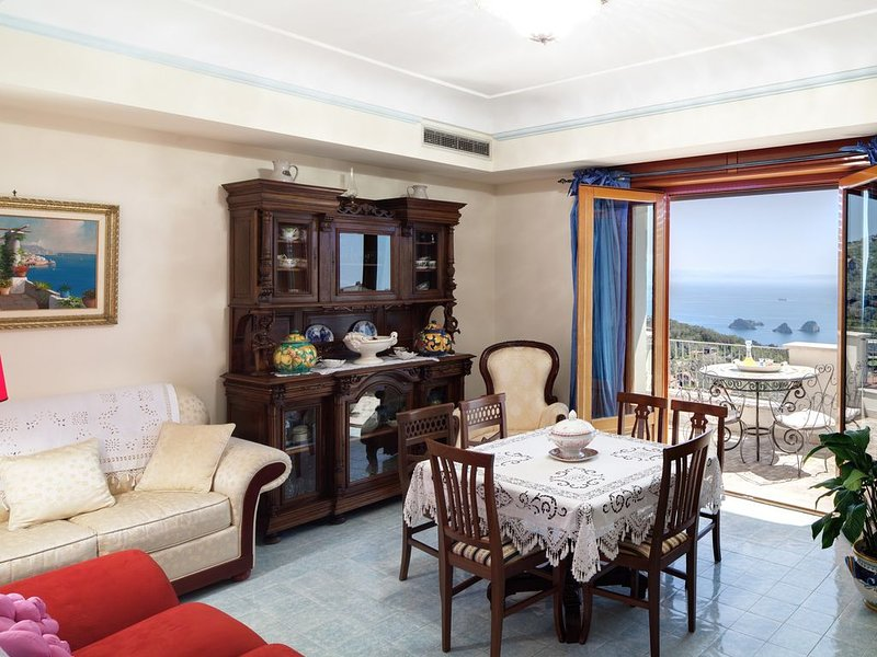 Living room with terrace and sea view