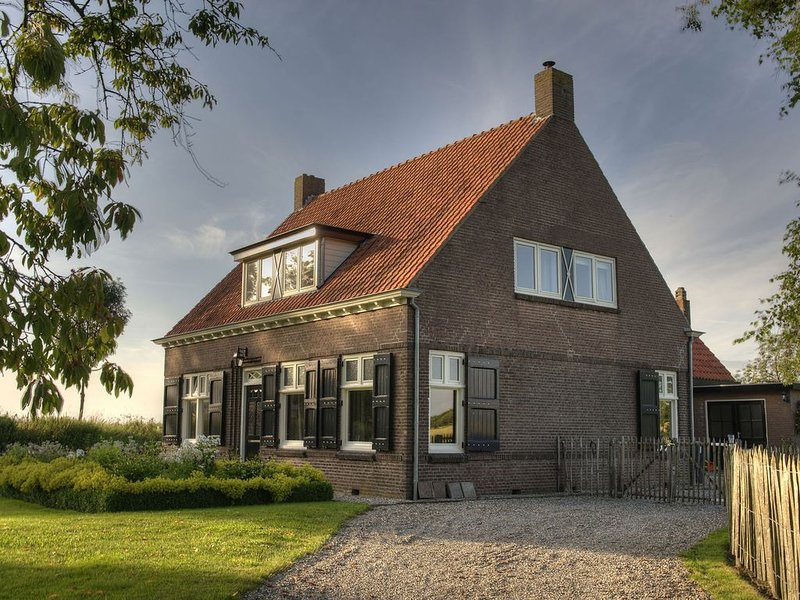 Spacious Farmhouse in IJzendijke with Garden, vacation rental in Oostburg