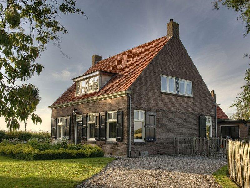 Spacious Farmhouse in IJzendijke with Garden, holiday rental in IJzendijke