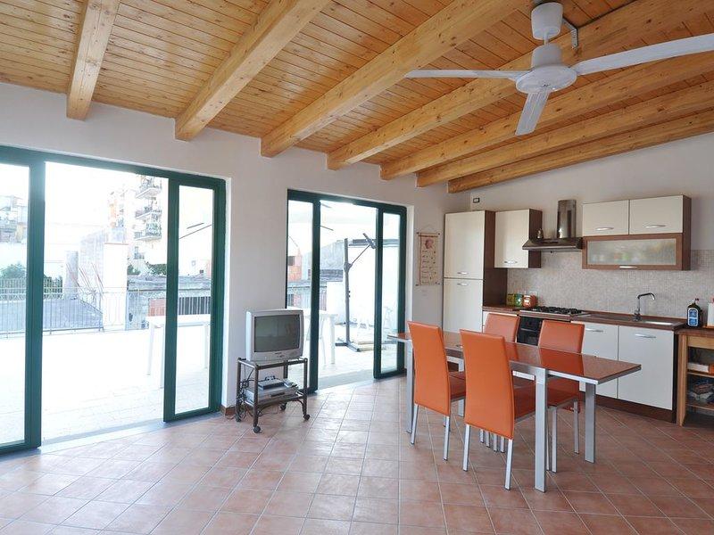 Attico a 30 mt. dal mare, location de vacances à Rocchenere