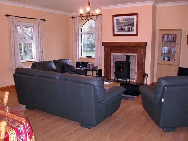 Large sitting room with comfortable seating & traditional stove & tv + dvd's