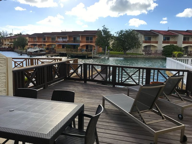 Sun deck with table and chairs, 2 sun loungers and BBQ