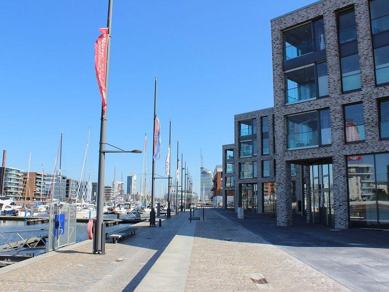 Zentral zwischen Deich und Neuen Hafen mit verglaster Loggia, location de vacances à Stadland