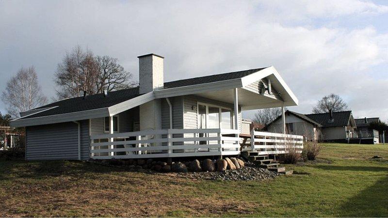 Gemütliches Holzferienhaus auf Rasengrund mit Terrasse, Whirlpool und Sauna, aluguéis de temporada em South Jutland