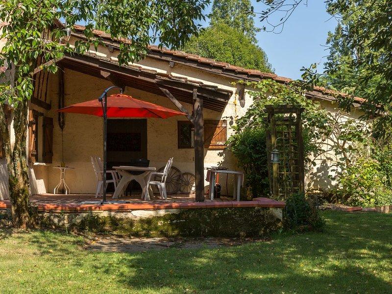 La terrazza e l'ingresso del cottage.
