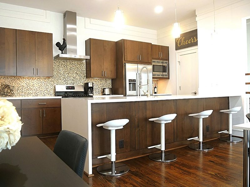 Fully furnished kitchen with bar.