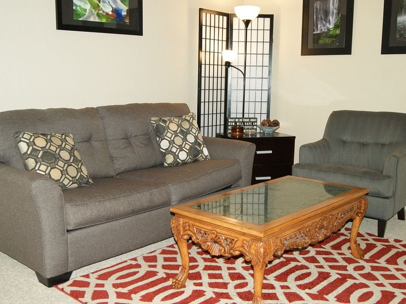 Unit #203 New Living Room. Put in a movie or grab a book and relax.