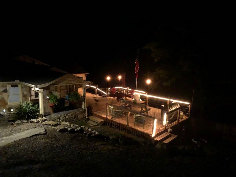 cabin and deck lighted at night