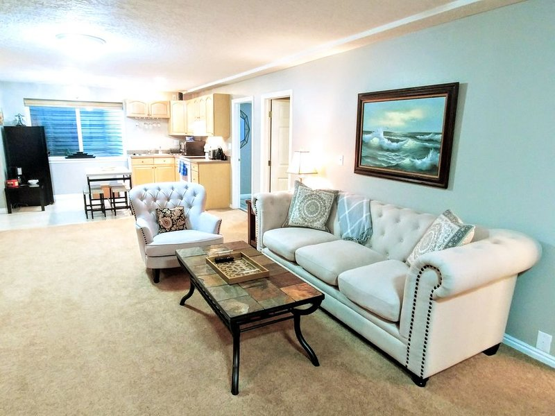 Huge living room with plenty of light, and tall ceilings. Open concept kitchen.