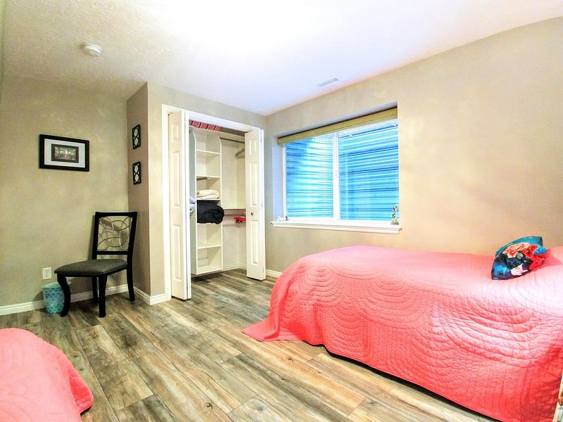 2nd bedroom, large window and closet with hangers